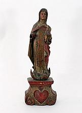 A carved and polychrome figure of the Virgin and C