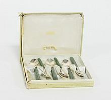 A set of eight silver tea spoons with New Zealand
