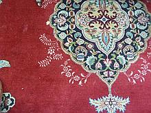 An Oriental style carpet, the central medallion an