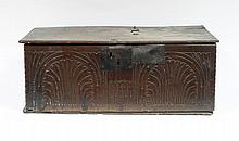 A 17th Century oak bible box with carved front, 69