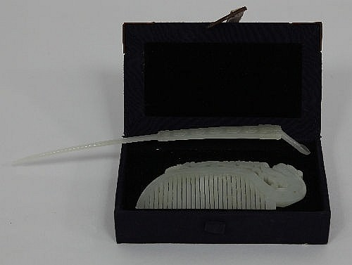 A Chinese pale celadon jade comb carved with a