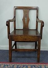 An early 19th Century oak armchair, with pierced