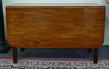 A mahogany drop-leaf dining table, on square