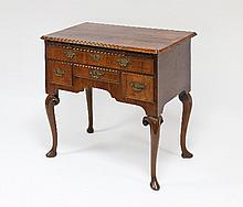 A George I walnut side table, the banded and