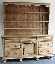 A Victorian pine dresser, the rack above three