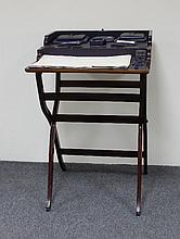 An Edwardian folding Dorothy desk, on X frame