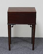 A small mahogany work box on square tapering legs,