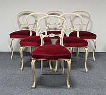 A set of six Victorian balloon back dining chairs,