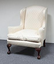 A George II style wing armchair, on cabriole legs