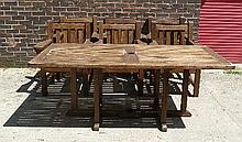 A set of six teak armchairs with slatted seats and