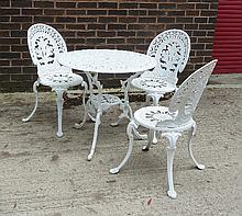 Three white painted garden chairs and a matching