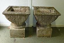 A pair of reconstituted stone garden vases of