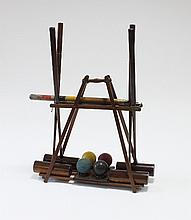 An ornamental croquet set, four mallets, four