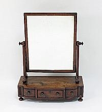 A George III mahogany three-drawer dressing table
