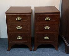 A pair of mahogany three drawer bedside tables, on