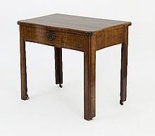 A George II walnut serpentine writing table, with