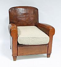 A leather upholstered armchair