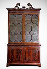 A George III style mahogany bookcase, with pierced