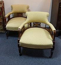 A pair of Edwardian tub armchairs each with padded