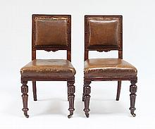 Two Edwardian walnut chairs with padded seats and