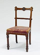 An oak single chair, the cresting rail carved an