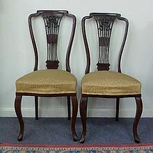 A set of six Edwardian salon chairs, with pierced