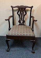 A George III style mahogany open armchair, with