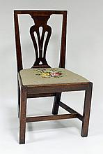 A George II oak dining chair, with pierced splat