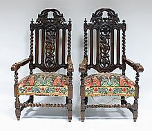 A pair of Carolean style carved oak armchairs