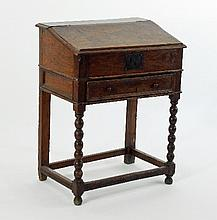 An elm writing box on a stand with hinged fall,