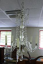 A five-branch glass chandelier, hung prismatic