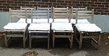 Eight teak garden chairs with ladder backs and