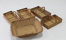 A collection of five basket weave flower trugs