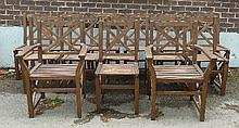 A set of fourteen teak garden chairs, with cross
