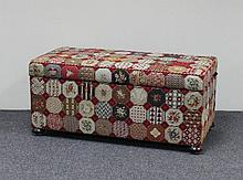 An ottoman covered in needlework fabric (modern),