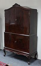 A mahogany cased drinks cabinet, the arched upper