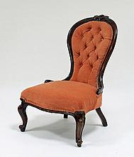 A Victorian walnut chair with carved surmount and