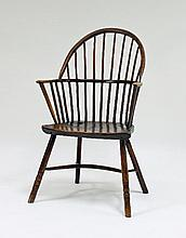 An early 19th Century stick back chair with solid