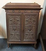 A 19th Century walnut hanging cabinet enclosed by