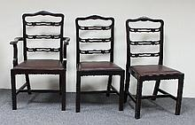 Seven ladder back dining chairs with loose trap