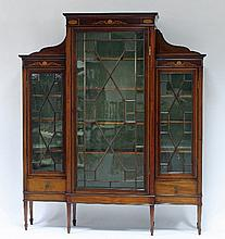An Edwardian breakfront mahogany inlaid display