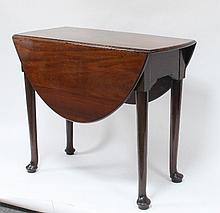 A George III mahogany two-flap oval table, raised