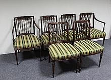 A set of six George III mahogany dining chairs of