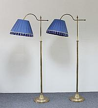 A pair of brass adjustable standard lamps, with