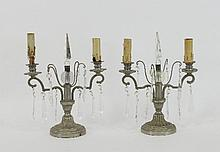 A pair of metal two-light candelabra, with glass