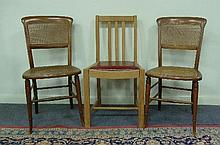 A pair of beech chairs with cane seat and back on