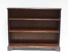 A mahogany bookcase, with brass handles to the