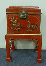 A 20th Century red japanned work box on a stand,