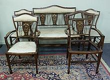 An Edwardian inlaid salon suite, comprising