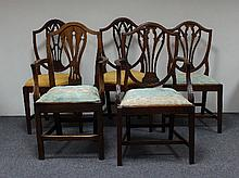Four George III style shield back dining chairs